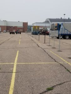 Temporary fence posts installed in the parking lot for Husker Harvest Days
