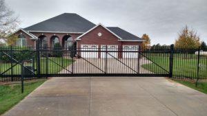 Ornamental cantilever driveway gate