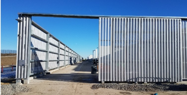 Industrial steel cantilever gate with long vertical louver pickets