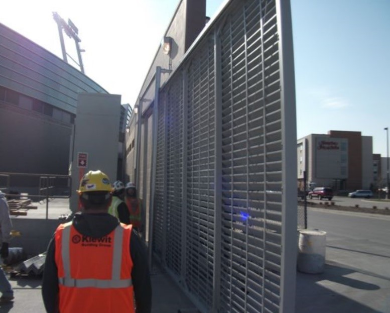 Horizontal louver cantilever gate installation at industrial facility