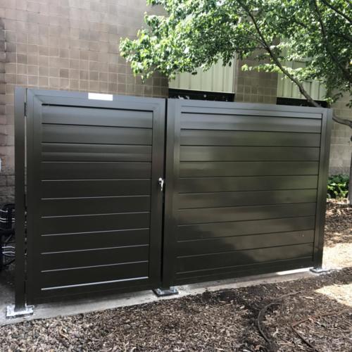 Solid aluminum industrial swing gate