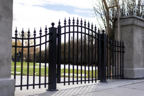 Black iron pedestrian swing gate silhouette