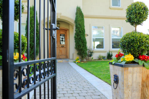 Entrance wrought iron pedestrian gate to luxury house