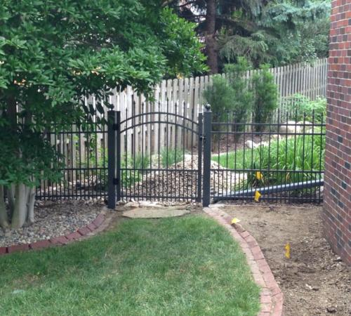 Residential garden gate with top arch, made of black ornamental iron