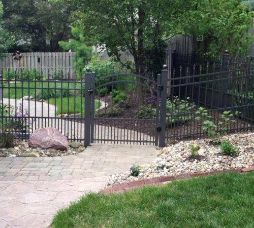 Pedestrian swing gate to a garden and backyard area