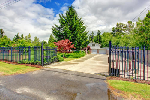 House exterior with open iron gate