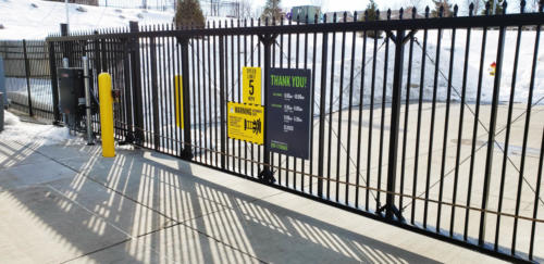 Industrial sliding gate made with ornamental iron with appropriate safety signage