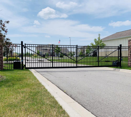 Industrial cantilever gate made with flat top ornamental iron