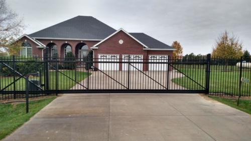 Residential black ornamental slide gate